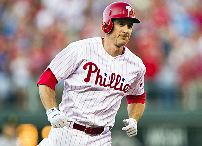 Chase Utley rounds the bases after hitting a homer in his first at-bat of the season, but the Pirates still beat the Phillies. (US Presswire)