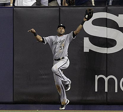 Chicago right fielder Alex Rios hangs on to make a leaping catch of Derek Jeter's deep fly for the final out. (AP)