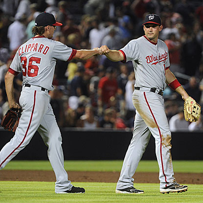 The Nationals' Ryan Zimmerman (right) congratulates Tyler Clippard on his scoreless ninth inning to earn the save.  (AP)