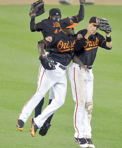 Xavier Avery, Adam Jones and Ryan Flaherty celebrate after the Orioles beat the Indians in Baltimore. (Getty Images)