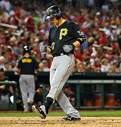 Clint Barmes crosses home plate after hitting a solo home run against the Cardinals. (Getty Images)