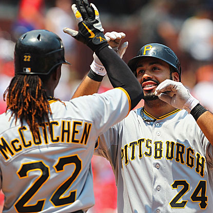 Pedro Alvarez is congratulated by teammate Andrew McCutchen following his first-inning grand slam.  (Getty Images)