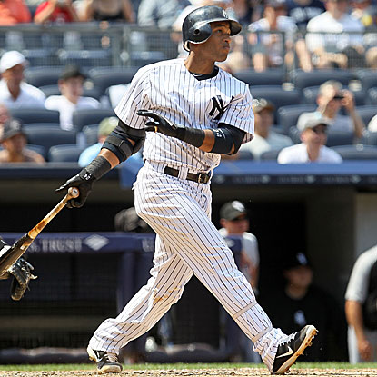 Robinson Cano's two-run homer puts the Yankees on top and is also the team's MLB-leading 124th round tripper.  (Getty Images)