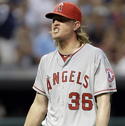 Jered Weaver reacts after striking out Shelley Duncan to get out of a bases-loaded jam in the seventh inning.  (AP)