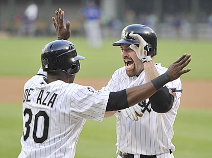 Alejandro De Aza greets Kevin Youkilis after the veteran hits a home run in first home plate appearance for the Pale Hose. (Getty Images)