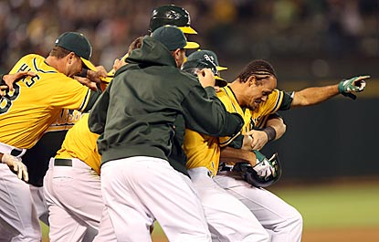 Coco Crisp starts the scoring with a long fly and ends it with another run-scoring fly ball, and his teammates appreciate it.  (Getty Images)