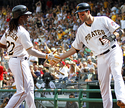 Andrew McCutchen (left) and Neil Walker celebrate after scoring on Pedro Alvarez's single in the seventh inning. (Getty Images)