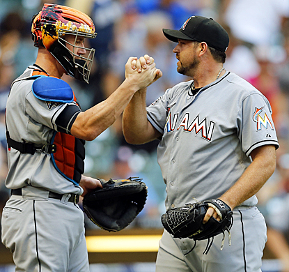 After coughing up a lead the day before, Heath Bell celebrates with John Buck after holding off the Brewers in the 10th inning. (AP)