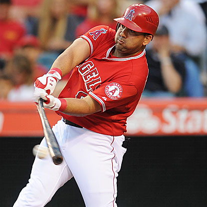Kendrys Morales collects three hits and three RBI, including a big two-run single in the Angels' five-run fourth inning.  (US Presswire)