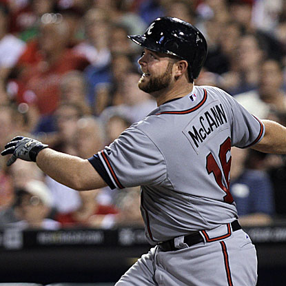 Brian McCann's eighth-inning grand slam breaks open the game for the Braves, as they go on to defeat the Phillies.  (AP)