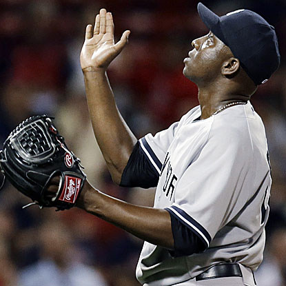 Rafael Soriano goes 1 1/3 innings to earn his 20th save of the season as the Yankees defeat the Red Sox.  (AP)