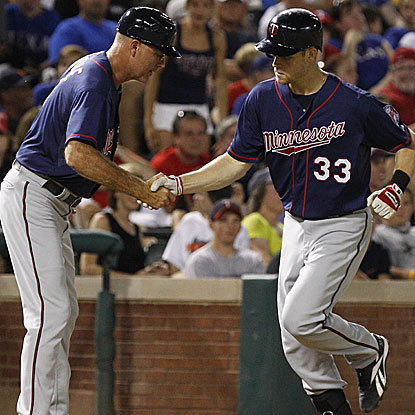 Justin Morneau homers and collects an RBI single as the Twins knock off the Rangers.  (AP)