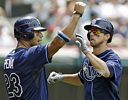 Carlos Pena (left) and Ben Zobrist celebrate after scoring on Luke Scott's double in the sixth inning. (AP)