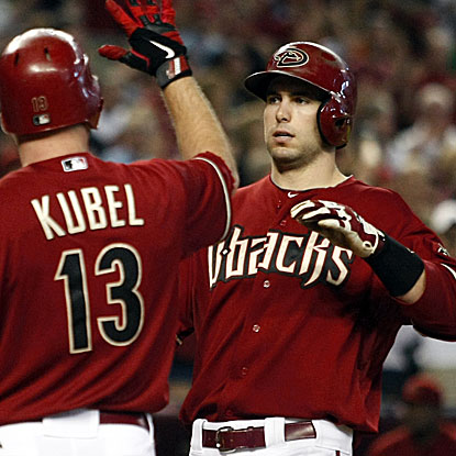 Paul Goldschmidt (right) homers, doubles and knocks in a career-high four runs to lead the Diamondbacks past the Dodgers.  (AP)