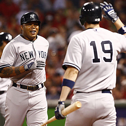 The Yankees' Andruw Jones (left) connects for his fourth home run in three games against the Red Sox this weekend.  (US Presswire)