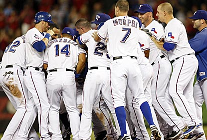 Somewhere in this mob is Ian Kinsler, whose single in the 13th gives the Rangers an unlikely win.  (US Presswire)