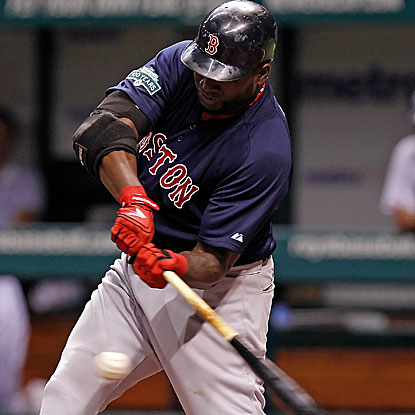 The Red Sox's David Ortiz hits a solo home run in the first inning to extend his hitting streak to eight games.  (AP)