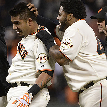 Hector Sanchez (left) singles home Pablo Sandoval (right) in the bottom of the 12th inning to put the Giants over the Astros.  (Getty Images)