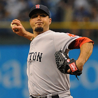 After a rocky first inning, the Red Sox's Josh Beckett settles down to throw six effective innings and beat the Rays.  (Getty Images)