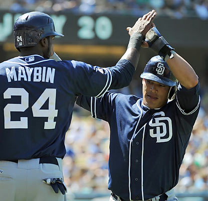 Everth Cabrera (right) scores the go-ahead run for the Padres, who score six unearned runs late to rally past the Dodgers. (Getty Images)
