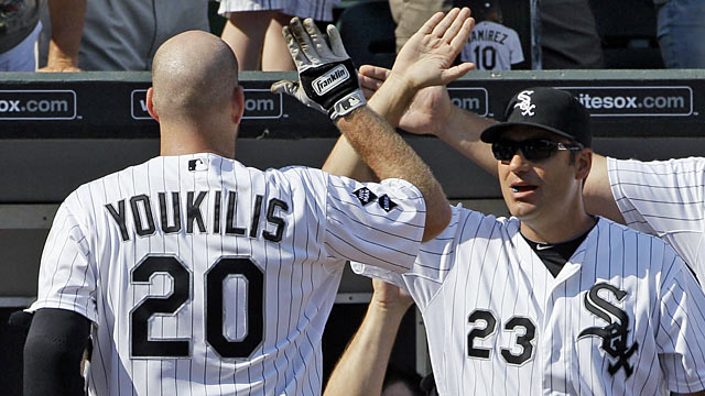 Unlike Bobby Valentine, White Sox manager Robin Ventura (right) embraces the presence of Kevin Youkilis. (AP)