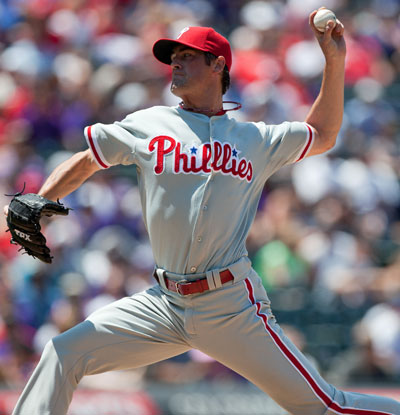 Cole Hamels gives up just one run in eight innings to earn his first career win at Coors Field.  (Getty Images)