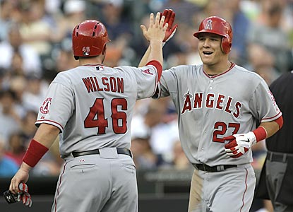 Mike Trout (27) is congratulated by Bobby Wilson after hitting a two-run shot in the second inning. (AP)