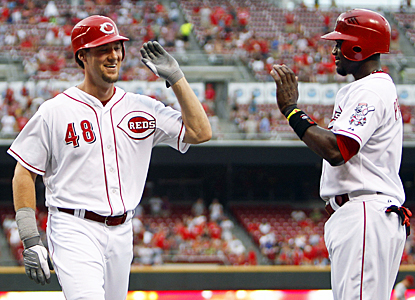 Ryan Ludwick (left) helps get Cincinnati off to a fast 4-0 lead with a three-run roundtripper in the first inning.   (US Presswire)