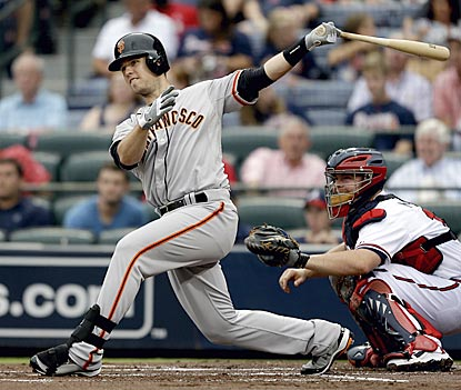Buster Posey follows through on a double in the first inning that opens the scoring.  (AP)