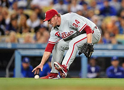 Roy Halladay makes a fielding error in the fifth inning, but pitches out of it and gives Philadelphia a chance to win.  (US Presswire)
