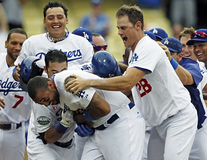 The Dodgers are ecstatic to have Matt Kemp back in the lineup. The slugger ends the game with a walk-off blast in the 12th. (AP)