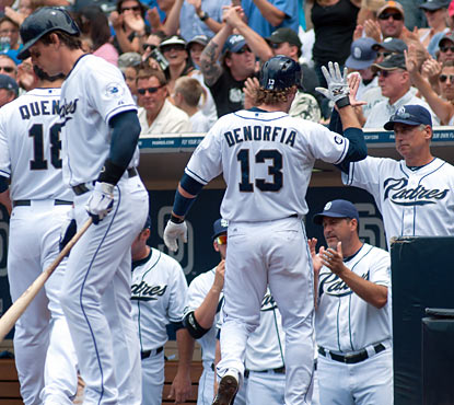 Manager Bud Black (right) congratulates Chris Denorfia (1 for 2, 2 RBI), who scores in the fourth inning. (Getty Images)