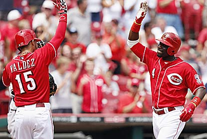 Brandon Phillips silences the booing crowd, driving in five runs to help the Reds overcome a 6-0 deficit. (Getty Images)