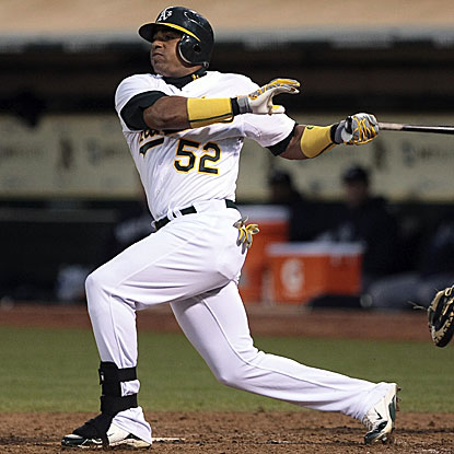 Yoenis Cespedes smacks a two-run homer in the first inning to help the A's end the Yankees' nine-game win streak in Oakland.  (US Presswire)