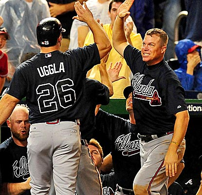 Chipper Jones congratulates Dan Uggla after Uggla scores the run that caps the Braves' huge comeback.  (US Presswire)
