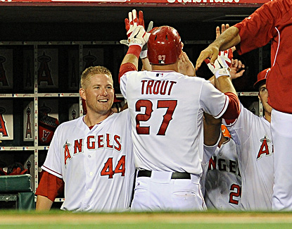 Mike Trout high-fives Mark Trumbo (left) in the dugout after hitting a solo home run in the seventh inning. (US Presswire)