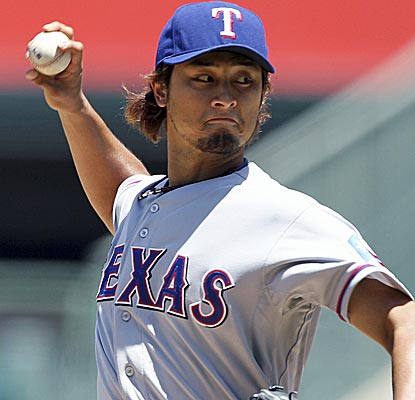 Rangers starter Yu Darvish goes seven innings for the win, striking out 11 for the fourth time this year.  (AP)