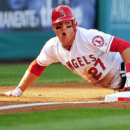 The Angels' Mike Trout scores a run in his 14th consecutive game to set an American League rookie record.  (US Presswire)