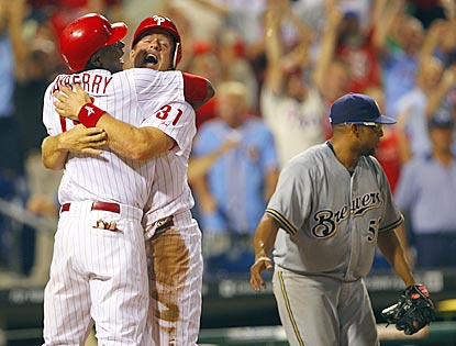 John Mayberry (far left) and Erik Kratz celebrate Philly's victory while Francisco Rodriguez contemplates another blown save.  (Getty Images)