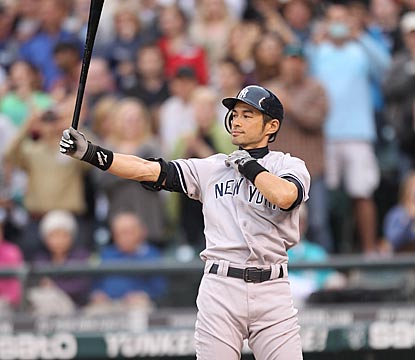 While Seattle fans give him a standing ovation, Ichiro Suzuki gets into his familiar stance in a starkly unfamiliar uniform.  (Getty Images)