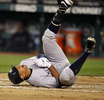 A-Rod goes down in pain after a King Felix pitch hits him in the left hand. The Yanks say there is no timetable for his return. (AP)