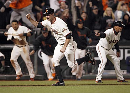 Brandon Belt, who replaces Pablo Sandoval as first baseman after his injury, scoots home with the winning run.  (US Presswire)