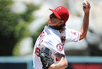 Jered Weaver strikes out eight over five innings, giving up only Billy Butler's two run homer. (Getty Images)