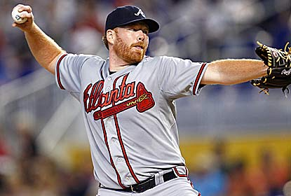 Tommy Hanson manages to beat the Marlins despite giving up seven walks and seven steals over five innings. (Getty Images)