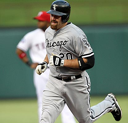 Kevin Youkilis circles the bases after hitting a home run, contributing to the White Sox's 35 runs over the last four games.  (Getty Images)