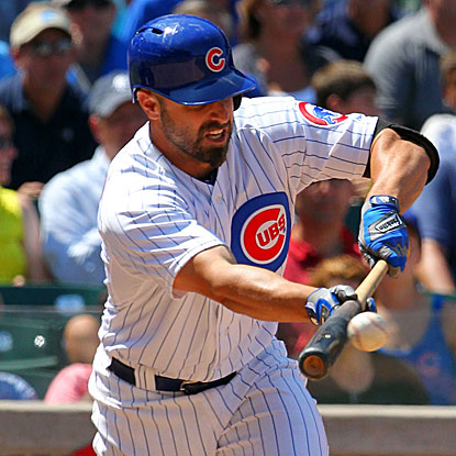 Pinch hitter Reed Johnson lays down a bunt single in the seventh inning to drive in the Cubs' go-ahead run.  (US Presswire)