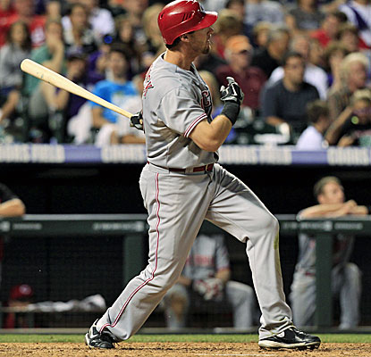 Ryan Ludwick watches the path of the ball, his leadoff, solo home run in the eighth inning. (AP)