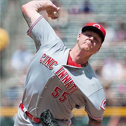 Mat Latos strikes out eight in eight strong innings of work in the Reds' 10th straight win, two shy of their franchise record.  (Getty Images)