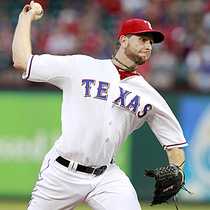 The Rangers' Scott Feldman throws eight shutout innings to win his fifth consecutive decision. (US Presswire)