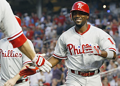 Jimmy Rollins contributes with an inside-the-park home run against Stephen Strasburg and the Nats. (AP)